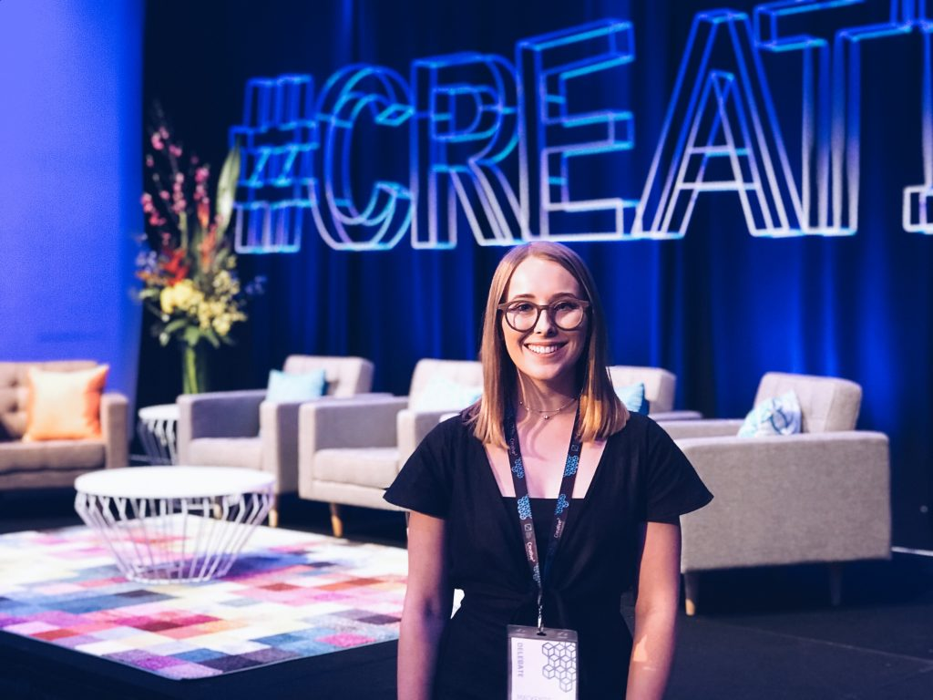 Mackenzie standing inside the creative 3 conference