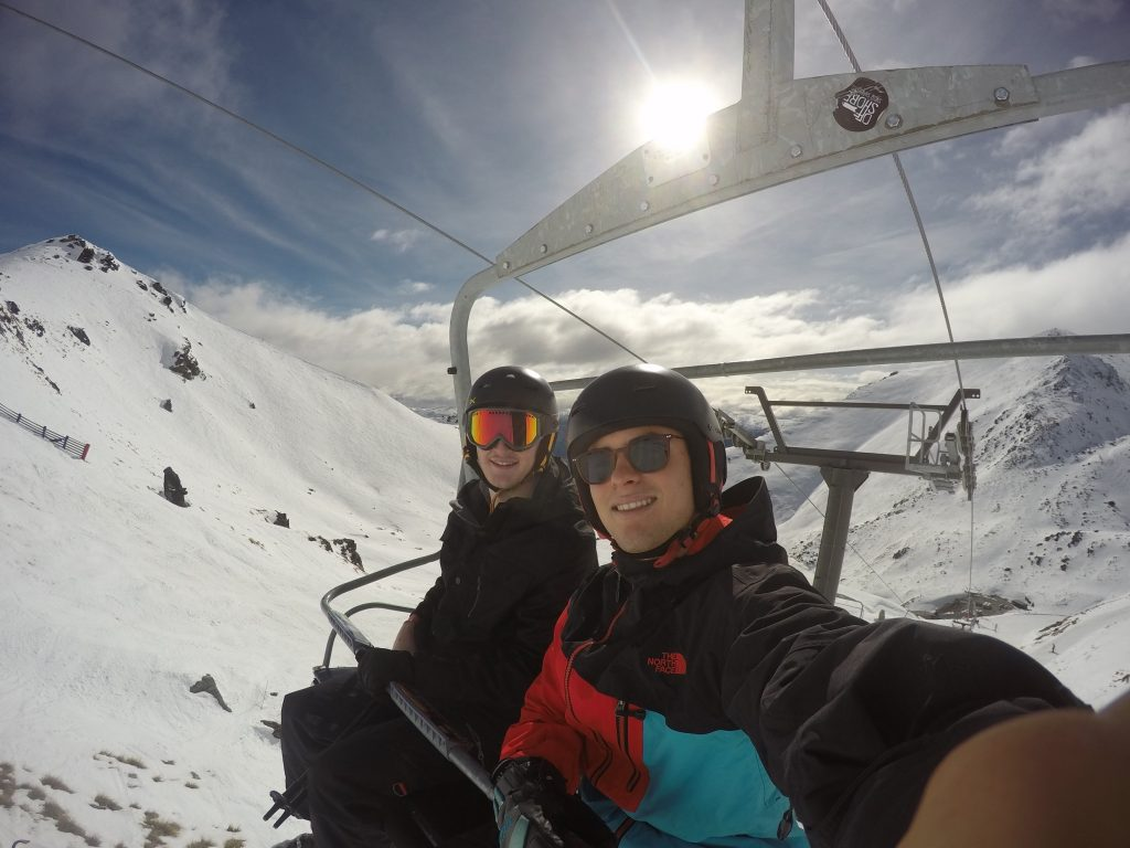 Brodie and friend on a ski lift in New Zealand