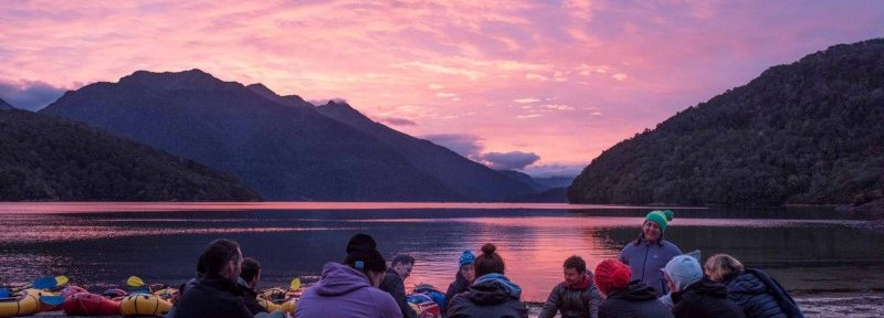 Group reflections at Lake Manapouri