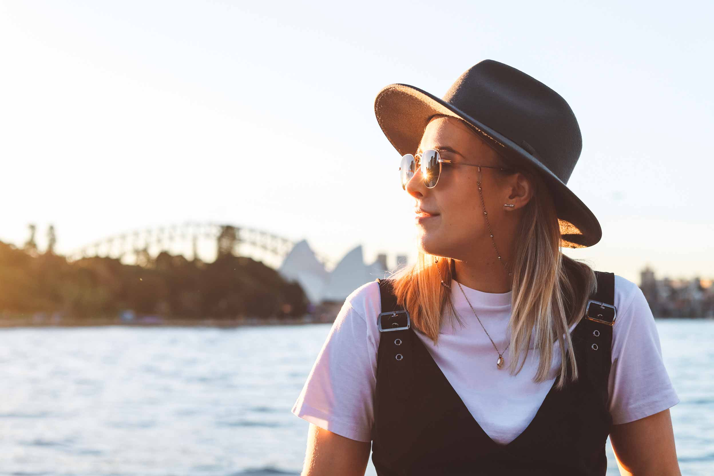 Girl standing in front of the Sydney harbour