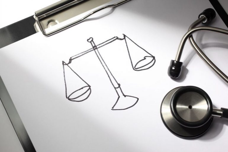 Stethoscope and scales of justice sketch