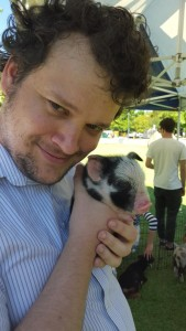 Caleb with the cutest baby piglet! Nawww!