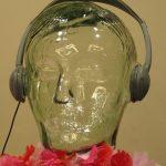 Glass head with headphones