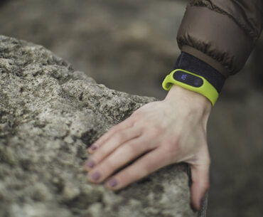 Decorative image showing arm wearing a fitbit device