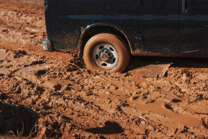 SUV wheel stuck in mud