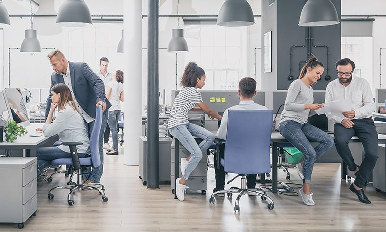 Modern office with team of workers