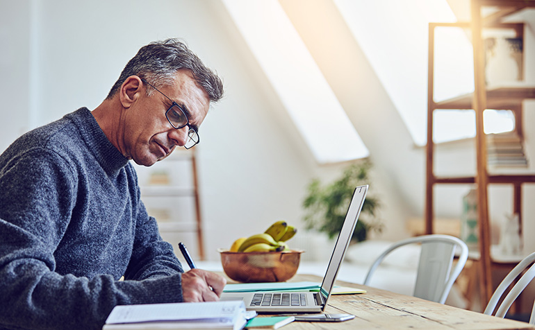Mature man working in a home office