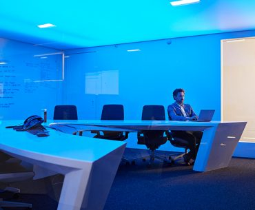Business man in meeting room alone
