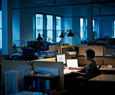 Worker along in office at night