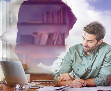 Man working at computer and thinking