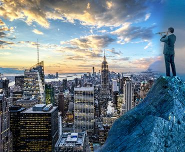 business man with telescope on a mountain top, looking to a cityscape