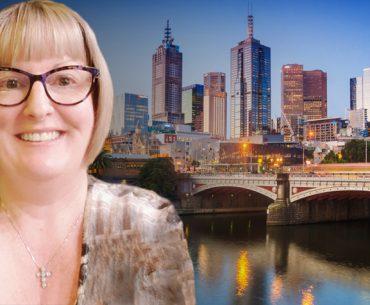 Jennifer Koulis in front of Melbourne city skyline