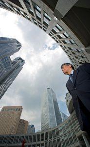 Business man with city skyline