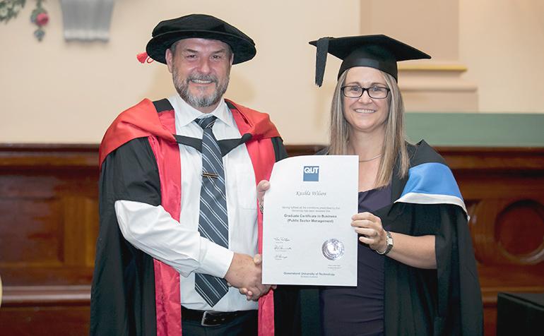 Kushla Wilson receives her Graduation Certificate