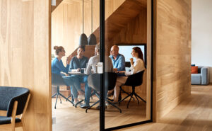 Modern office with group of business people in a meeting